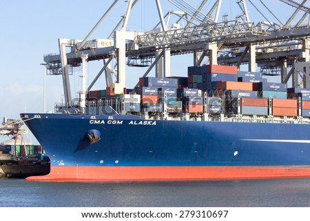 ROTTERDAM - JAN 13, 2012: CMA CGM Alaska container ship at the ECT Terminal in the Port of Rotterdam. It�´s the Europ's largest port and facilitate the needs of a hinterland with 40,000,000 consumers. - stock photo