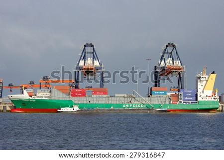 ROTTERDAM - JAN 13, 2012: Container ship moored at the Euromax Terminal in the Port of Rotterdam. The port is the Europ's largest and facilitate the needs of a hinterland with 40,000,000 consumers. - stock photo