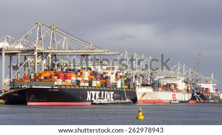 ROTTERDAM - JAN 13, 2012: Container ships moored at the ECT Terminal in the Port of Rotterdam. The port is the Europ's largest and facilitate the needs of a hinterland with 40,000,000 consumers. - stock photo