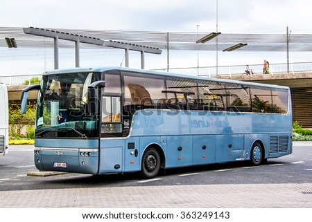 ROTTERDAM, NETHERLANDS - AUGUST 9, 2014: Intercity coach bus Van Hool T916 Alicron in the city street. - stock photo