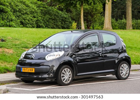 ROTTERDAM, NETHERLANDS - AUGUST 9, 2014: Motor car Citroen C1 at the city street. - stock photo