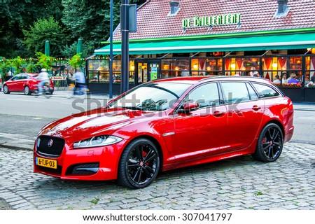 ROTTERDAM, NETHERLANDS - AUGUST 9, 2014: Motor car Jaguar XF at the city street. - stock photo