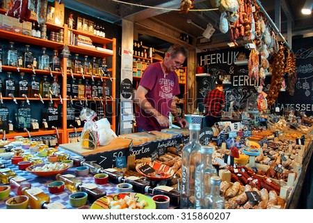 "ROTTERDAM - NETHERLANDS ; ""Heerlijk en eerlijk "" is one of the many delicatessen shops at the famous Markethal of Rotterdam on 12 september 2015  - stock photo"