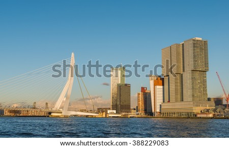Rotterdam, Netherlands - March 7, 2016: Erasmus Bridge with Skyscraper in Rotterdam, The Netherlands. Rotterdam has always been one of the main centres of the shipping industry in the Netherlands. - stock photo