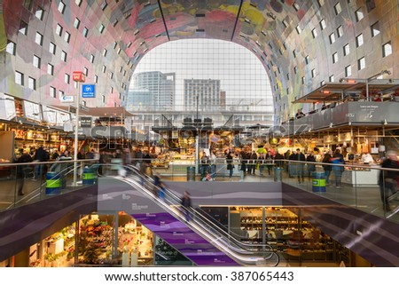 Rotterdam, Netherlands - March 4, 2016: Retail Shop in Markthal (Market hall) a new icon in Rotterdam. The covered food market and housing development shaped like a giant arch - stock photo