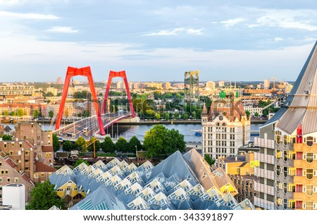 ROTTERDAM, NETHERLANDS - MAY 23, 2014 - The cubic houses of Piet Blom, Witte Huis and Williamsburg bridge - stock photo