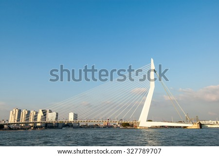 ROTTERDAM, NETHERLANDS - SEP 20, 2005: Erasmus Bridge 'The Swan' over New Meuse River in Rotterdam, the Netherlands - stock photo