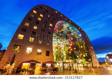ROTTERDAM, NETHERLANDS - SEPTEMBER 03, 2015: market hall at night, a residential and office building with market hall underneath opened on Oct 1, 2014, by Queen Maxima designed by architect firm MVRDV - stock photo