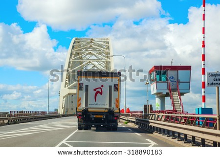 ROTTERDAM, NETHERLANDS - SEPTEMBER 04, 2015: traffic on the Ring Rotterdam. The Ring Rotterdam is the largest and most traveled highway loop of the Netherlands - stock photo