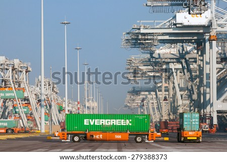 ROTTERDAM - OCT 1, 2011: Robot truck with containers in the ECT Terminal in the port of Rotterdam. This port is the Europe's largest and facilitate the needs of a hinterland with 40,000,000 consumers. - stock photo