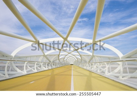 ROTTERDAM - OCTOBER 4, 2014: Cycling bridge the Green Connection. It connects the urban south of Rotterdam with the newly developed recreational area Buijtenland van Rhoon, crossing the A15 highway. - stock photo