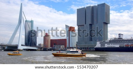 ROTTERDAM - SEPTEMBER 7, 2013: The World Port Days at the port of Rotterdam  on September 7 , 2013 in Rotterdam, Netherlands. Showing many boats on the Maasriver and around the famous Erasmus bridge.  - stock photo