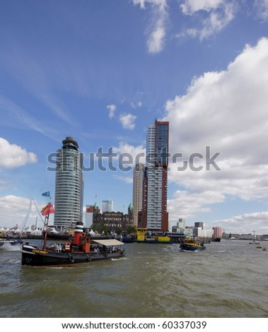 ROTTERDAM - SEPTEMBER 4: The World Port Days in the port of Rotterdam showing many boats on the maasriver and around the famous Erasmus bridge on September 4 , 2010 in Rotterdam, Netherland - stock photo
