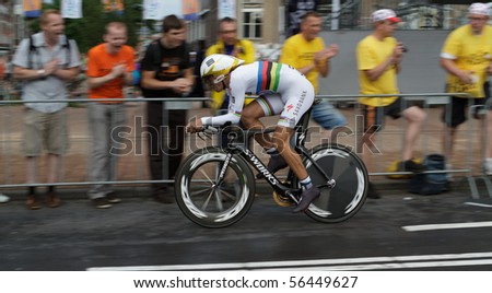 ROTTERDAM, THE NETHERLANDS - JULY 3: Fabian Cancellara on his way to a first position in the 2010 Tour de France prologue time trial. July 3, 2010 in Rotterdam, The Netherlands - stock photo