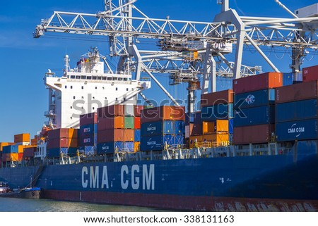 ROTTERDAM, THE NETHERLANDS, MAY 24, 2015: Large CMA CGM container vessel unloaded in Port of Rotterdam - stock photo