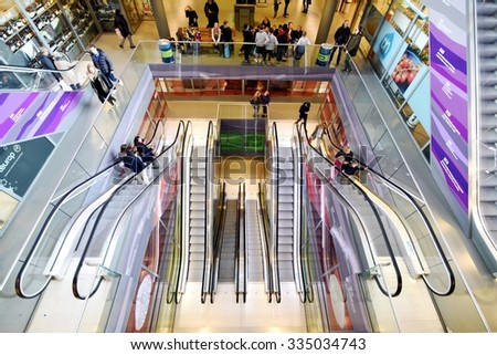 ROTTERDAM, THE  NETHERLANDS - NOVEMBER 1, 2015: View from above of new generation of shopping mall with escalators and customers in Rotterdam center. View from above on  November 1, 2015 - stock photo