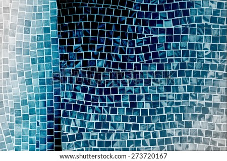 rough blue mosaic tile wall in bathroom - stock photo