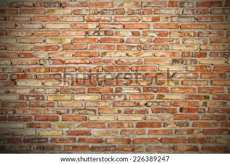 rough brick wall background texture with vignette - stock photo