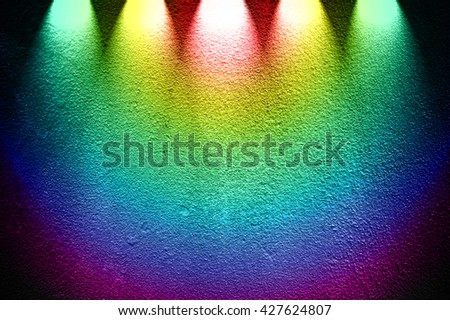 rough concrete wall with colorful spotlight - stock photo