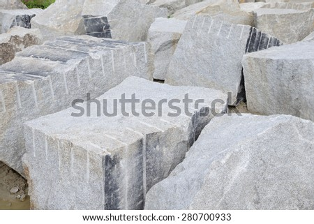 Rough granite blocks for construction industry  - stock photo