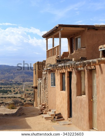 Rough-hewn buildings and scenic views characterize the Acoma Pueblo in New Mexico. - stock photo