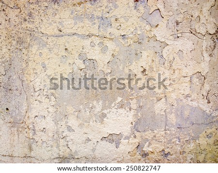 Rough plaster on the wall with colored spots. - stock photo