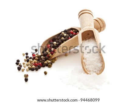 rough salt and mixed peppercorns on wooden shovels, isolated on white - stock photo