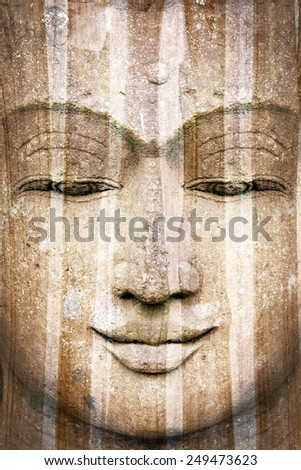 Rough stone Buddha face - stock photo