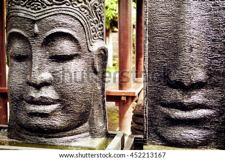 Rough stone Buddha face, statue on Bali market - stock photo