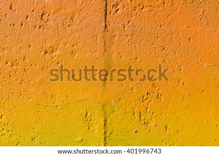 Rough texture of a colorful painted wall - stock photo