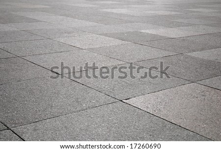 Rough texture of wet block pavement - stock photo