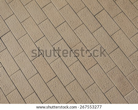 Rough textured stone tiles, exterior walkway, perspective view. Large square slab patterned flooring. Horizontal photo - stock photo