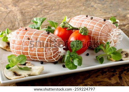 Roulade of meat stuffed on complex background - stock photo