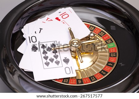 Roulette And Playing Card - stock photo