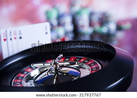 Roulette in casino and Poker Chips - stock photo