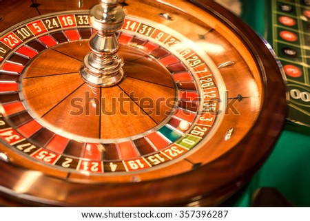 Roulette in the casino close-up. Contrast picture of roulette. - stock photo