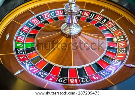 Roulette wheel in casino - stock photo