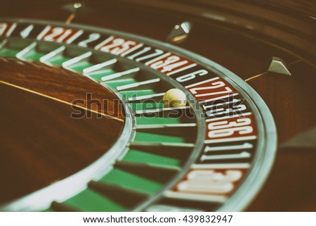 Roulette wheel in casino close-up - stock photo