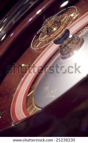 roulette wheel in motion - stock photo