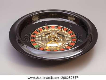 Roulette wheel isolated on gray background - stock photo
