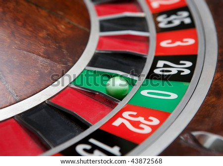 Roulette wheel with ball on zero - stock photo