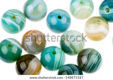 Round Agate beads in blue, green and Brown with nice patterns and polish. - stock photo
