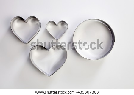 round and heart shape cutter on the white background - stock photo