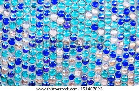 Round blue glass mosaic pattern background - stock photo