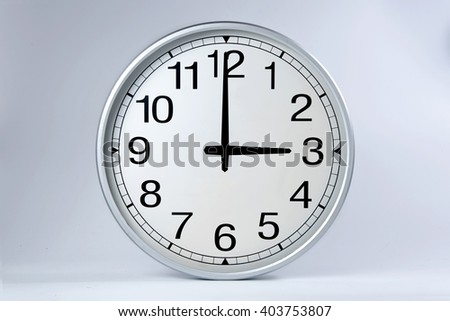 Round clock shows shows at 3 o'clock,  - stock photo