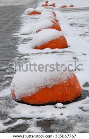 round concrete road slab bright colors under the snow - stock photo