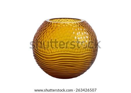 Round, fluted, orange glass vase isolated on white background - stock photo