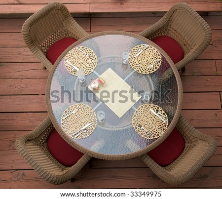 Round Glass table with four chairs from above - stock photo