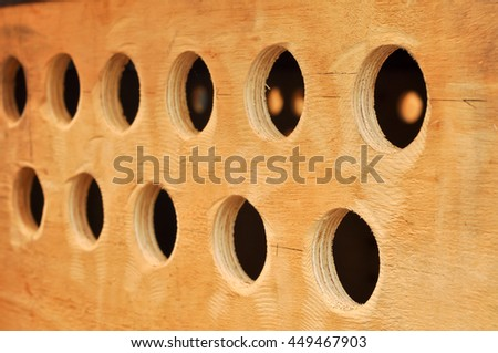 Round hole on the plywood used for the ventilation of the cargo box. - stock photo