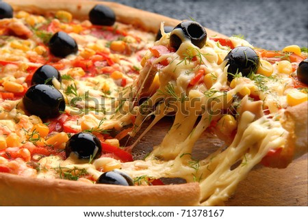 Round Italian pizza with salami, olives, capsicum and cheese - stock photo